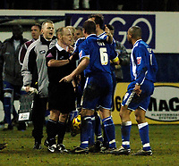 Photo: Daniel Hambury.<br />Luton Town v Cardiff City. Coca Cola Championship. 14/02/2006.<br />Referee Andy Woolmer (centre) is surrounded by Cardiff players after a controversial finish.