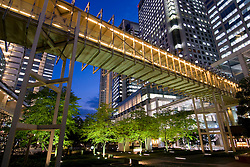 Modern urban architecture and park landscaping at night in Shinagawa Tokyo