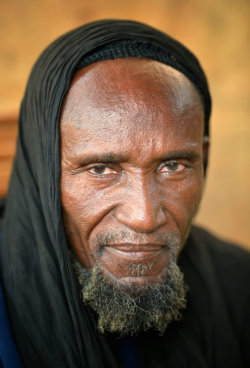 A man displaced from his home town of Gossi, Mali, living in a rented house with his family in Mopti. They were displaced by fighting when Islamist rebels seized control of the north of Mali in 2012. The Islamists were chased out in early 2013 by French troops. Many displaced and refugee families have yet to return, preferring to wait for better security and improved economic conditions in the north.