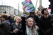 Extinction Rebellion listen to protesters speaking from a tower as disruption begins and activists block 12 sites around Westminster on 7th October 2019 in London, England, United Kingdom. Extinction Rebellion is a climate change group started in 2018 and has gained a huge following of people committed to peaceful protests. These protests are highlighting that the government is not doing enough to avoid catastrophic climate change and to demand the government take radical action to save the planet.