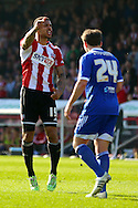 Andre Gray goal celebration scoring Brentfords first during the Sky Bet Championship match between Brentford and Nottingham Forest at Griffin Park, London, England on 6 April 2015. Photo by Matthew Redman.