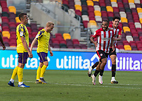 Football - 2020 / 2021 Sky Bet (EFL) Championship - Brentford vs. Huddersfield Town <br /> <br /> Bryan Mbeumo (Brentford  FC) turns away after scoring his teams third goal with a spectacular effort  at the Brentford Community Stadium<br /> <br /> COLORSPORT/DANIEL BEARHAM