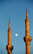 Tur.mw2.58.xs..Moon and mosque minarets of the Ottoman mosque called Mecidiye Camii, which sits at the foot of the Bogazici bridge. Istanbul, Turkey. Muslim, Islam, Architecture, Religion..