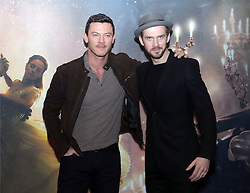 Luke Evans (left) and Dan Stevens during a photo call with the cast of Beauty and the Beast, at The Corinthia Hotel, London.