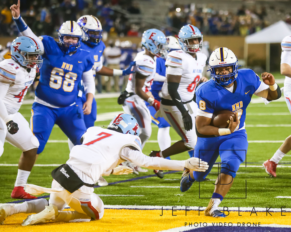 North Myrtle Beach Chiefs Devin Montgomery (8) rushes for a touchdown against the AC Flora Falcons during the first half the state championship game at Benedict College.