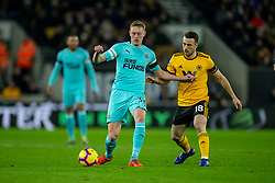 February 11, 2019 - Wolverhampton, England, United Kingdom - Sean Longstaff of Newcastle United under pressure from Diogo Jota of Wolverhampton Wanderers  during the Premier League match between Wolverhampton Wanderers and Newcastle United at Molineux, Wolverhampton on Monday 11th February 2019. (Credit Image: © Mi News/NurPhoto via ZUMA Press)