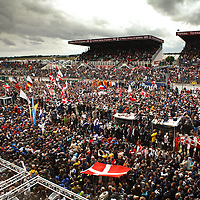 Crowds swarm onto track after the race celebrating the drivers on the podium (Le Mans 24H 2013)