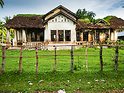 17 JUNE 2016 - DON KHONE, CHAMPASAK, LAOS: The old elementary school in the village on Don Khon. Don Khon Island, one of the larger islands in the 4,000 Islands chain on the Mekong River in southern Laos. The island has become a backpacker hot spot, there are lots of guest houses and small restaurants on the north end of the island.        PHOTO BY JACK KURTZ