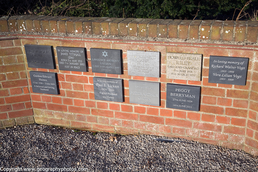 Memorial wall plaques on red brick wall of country church, Shottisham, Suffolk, England