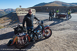 """Scott Wages, the """"Golden Ticket"""" winner, won the opportunity to ride the entire Cannonball on this 1936 Harley-Davidson Knucklehead from Carl's Cycle, shown here at the top of Loveland Pass during Stage 10 (278 miles) of the Motorcycle Cannonball Cross-Country Endurance Run, which on this day ran from Golden to Grand Junction, CO., USA. Monday, September 15, 2014.  Photography ©2014 Michael Lichter."""