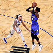 ORLANDO, FL - FEBRUARY 19:  Terrence Ross #31 of the Orlando Magic attempts a shot over Damion Lee #1 of the Golden State Warriors during the first half at Amway Center on February 19, 2021 in Orlando, Florida. NOTE TO USER: User expressly acknowledges and agrees that, by downloading and or using this photograph, User is consenting to the terms and conditions of the Getty Images License Agreement. (Photo by Alex Menendez/Getty Images)*** Local Caption *** Terrence Ross; Damion Lee