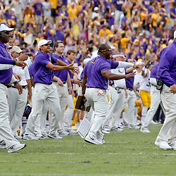 Oct 12, 2013; Baton Rouge, LA, USA; LSU Tigers head coach Les Miles and his coaching staff react from the sideline following a defensive stop against the Florida Gators during the second half of a game at Tiger Stadium. LSU defeated Florida 17-6. Mandatory Credit: Derick E. Hingle-USA TODAY Sports