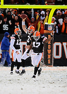 Derek Anderson, center, Braylon Edwards, left, and Lawrence Vickers celebrate the win..The Cleveland Browns continued their playoff hunt with an 8-0 win over visiting Buffalo.  .Photo by David  Richard