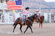 08 SEPTEMBER 2007 -- FT. DEFIANCE, AZ: A student from Red Mesa High School on the Navajo Indian Reservation carries the American flag around the arena during the Grand Entry at the All Women Rodeo in the Dahozy Stampede Rodeo Arena in Ft. Defiance, AZ, on the Navajo Indian Reservation. It was the first all women's rodeo on the Navajo Indian Reservation.  Photo by Jack Kurtz/ZUMA Press