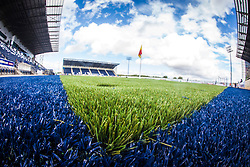 A landscape image taken with a fish-eye lens of the new plastic pitch at The Falkirk Stadium, with the new pitch work for the Scottish Championship game v Morton. The woven GreenFields MX synthetic turf and the surface has been specifically designed for football with 50mm tufts compared with the longer 65mm which has been used for mixed football and rugby uses.  It is fully FFA two star compliant and conforms to rules laid out by the SPL and SFL.<br /> ©Michael Schofield.