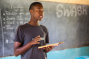 George Dennis  sets out a plan with the team of volunteers as they prepare for their school training session with pupils as part of the ICS Raleigh SWASH (school water, sanitation and hygiene plan) project. Mbulu, Manyara district, Tanzania. Working in partnership with the Diocese of Mbulu Development Department (DMDD); part of Caritas Tanzania.