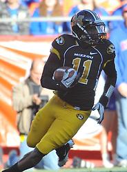 Nov 27, 2010; Kansas City, MO, USA; Missouri Tigers safety Jarrell Harrison (11) runs back the ball after intercepting in the second half of the game at Arrowhead Stadium. Missouri won 35-7.  Mandatory Credit: Denny Medley-US PRESSWIRE
