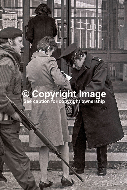 Army & police on security duty at polling station in N Ireland school during the 1973 Border Poll on N Ireland's Future. The school in question is Rosetta Primary in Belfast. 197303080042c.<br /> <br /> Copyright Image from Victor Patterson, Belfast, UK<br /> <br /> t: +44 28 9066 1296 (from Rep of Ireland 048 9066 1296)<br /> m: +44 7802 353836<br /> e: victorpattersonbelfast@gmail.com<br /> <br /> www.images4media.com<br /> <br /> Please see my full Terms and Conditions of Use at https://www.images4media.com/p/terms-conditions - it is IMPORTANT that you familiarise yourself with them.<br /> <br /> Images used online incur an additional cost. This cost should be agreed in writing in advance. Online images must be visibly watermarked i.e. © Victor Patterson or that of the named photographer within the body of the image. The original metadata must not be deleted from images used online.<br /> <br /> This image is only available for the use of the download recipient i.e. television station, newspaper, magazine, book publisher, etc, and must not be passed on to a third party. It is also downloaded on condition that each and every usage is notified within 7 days to victorpattersonbelfast@gmail.com.<br /> <br /> The right of Victor Patterson (or the named photographer) to be identified as the author is asserted in accordance with The Copyright Designs And Patents Act (1988). All moral rights are asserted.