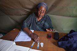 LUSAKA, Dec. 1, 2016 (Xinhua) -- A staff member shows AIDS test strips during an activity to raise awareness on World AIDS Day in Lusaka, capital of Zambia, on Dec. 1, 2016. (Xinhua/Peng Lijun) (zy) (Credit Image: © Xinhua via ZUMA Wire)