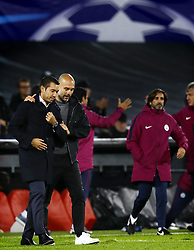 Coaches Giovanni van Bronckhorst of Feyenoord, Pep Guardiola of Manchester City his after 0-4 victory during the UEFA Champions League group F match between Feyenoord Rotterdam and Manchester City at the Kuip on September 13, 2017 in Rotterdam, The Netherlands
