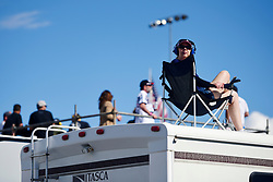 March 4, 2018 - Las Vegas, NV, U.S. - LAS VEGAS, NV - MARCH 04: A woman watches the race from the top of an RV during the Monster Energy NASCAR Cup Series Pennzoil 400 Sunday, March 4, 2018, at the Las Vegas Motor Speedway in Las Vegas, NV. (Photo by Sam Morris/Icon Sportswire) (Credit Image: © Sam Morris/Icon SMI via ZUMA Press)