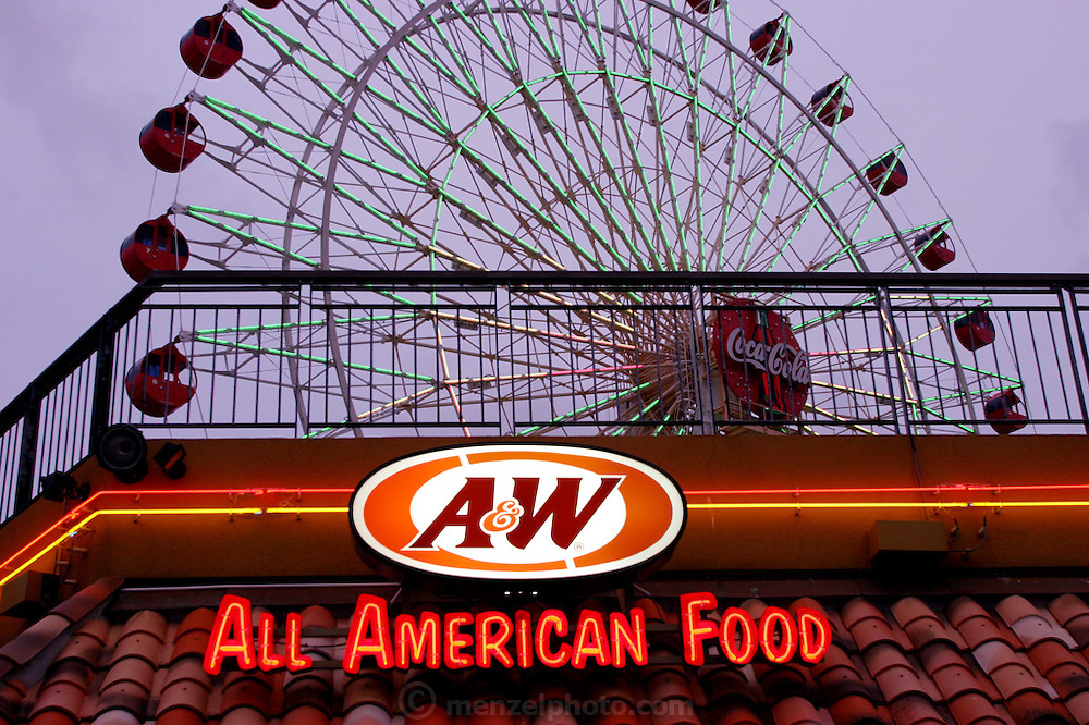 A&W and ferris wheel at Mihama American Village on Okinawa's main island. Okinawa, Japan. The A&W fast food chain is found all around Okinawa's main island, as are soft drink advertisements. (Supporting image from the project Hungry Planet: What the World Eats)