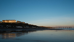 © Licensed to London News Pictures. 11/03/2014<br /> <br /> Saltburn by the Sea, England<br /> <br /> The first rays of morning sun light up the Upper Promenade area of Saltburn by the Sea in Cleveland.<br /> <br /> Photo credit : Ian Forsyth/LNP