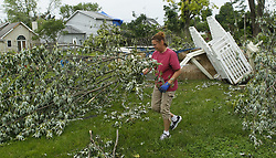 May 29, 2019 - Dayton, Ohio, USA - A woman cuts down and clean up her back yard  n Wed  May 29,2019 . After the Dayton area was hit hard bye Tornados on May 28,2019. (Credit Image: © Ernest Coleman/ZUMA Wire)