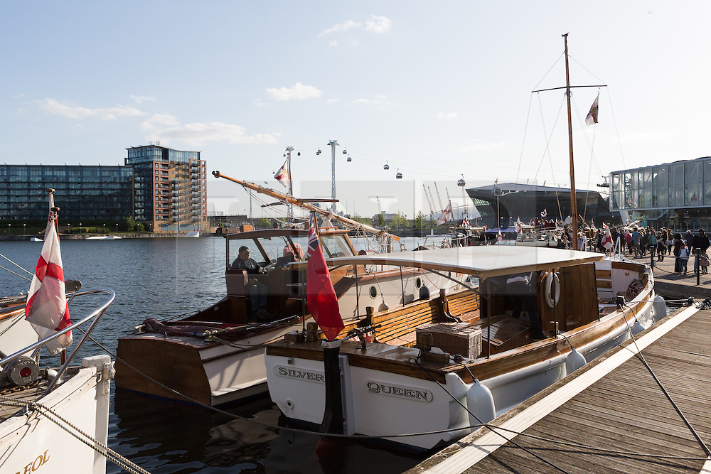 © Licensed to London News Pictures. 16/05/2015. London, UK. Dunkirk Little Ships moored at Royal Victoria Dock this evening. Over 20 Dunkirk Little Ships have gathered in London toay before leaving in the morning to continue their journey to Dunkirk to mark the 75th anniversary of the Dunkirk Evacuations. Photo credit : Vickie Flores/LNP
