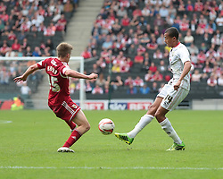 Milton Keynes Dons' Dele Alli is challenged by Bristol City's Joe Bryan   - Photo mandatory by-line: Nigel Pitts-Drake/JMP - Tel: Mobile: 07966 386802 24/08/2013 - SPORT - FOOTBALL - Stadium MK - Milton Keynes - Milton Keynes Dons V Bristol City - Sky Bet League One
