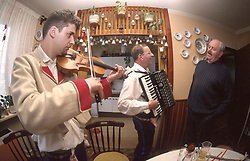 CZECH REPUBLIC MORAVIA BANOV APR98 -  Jan Chovanec (L) plays the violin for his elderly hosts Helena and Josef Vystrcil at their home.  During Easter, folklore dress, music and mutual visits are part of the customary traditional celebrations in Moravia.  jre/Photo by Jiri Rezac<br /> <br /> © Jiri Rezac 1998<br /> <br /> Tel:   +44 (0) 7050 110 417<br /> Email: info@jirirezac.com<br /> Web:   www.jirirezac.com