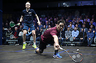 Paul Coll of New Zealand (wearing a Maroon shirt) plays a shot against  James Willstrop of England (wearing a Dark Blue shirt). Canary Wharf Squash Classic 2016 , day two at the East Wintergarden in Canary Wharf , London on Tuesday 8th March 2016.<br /> pic by John Patrick Fletcher, Andrew Orchard sports photography.