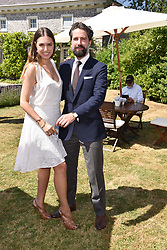 Amber Le Bon and Jack Guinness at the 'Cartier Style et Luxe' enclosure during the Goodwood Festival of Speed, Goodwood House, West Sussex, England. 15 July 2018.
