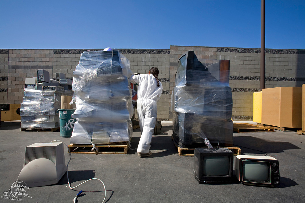 Electronic equipment, computers, stereos, TVs and even arcade games get put on pallettes and wrapped in plastic wrap. S.A.F.E Collection Center, Sun Valley, Bureau of Sanitation for the City of Los Angeles, California, USA
