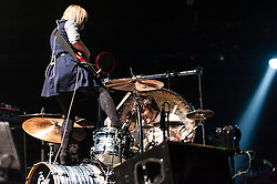 © Licensed to London News Pictures. 22/02/2013. London, UK.   Ritzy Bryan (left) and Matt Thomas (right) of The Joy Formidable performing live at Earls Court, supporting headliner Bloc Party.   The Joy Formidable is a Welsh alternative rock band formed in 2007 in North Wales and currently located in London, England. The band consists of Ritzy Bryan (lead vocals, guitar), Rhydian Dafydd (bass, backing vocals), and Matt Thomas (drums, percussion).Photo credit : Richard Isaac/LNP