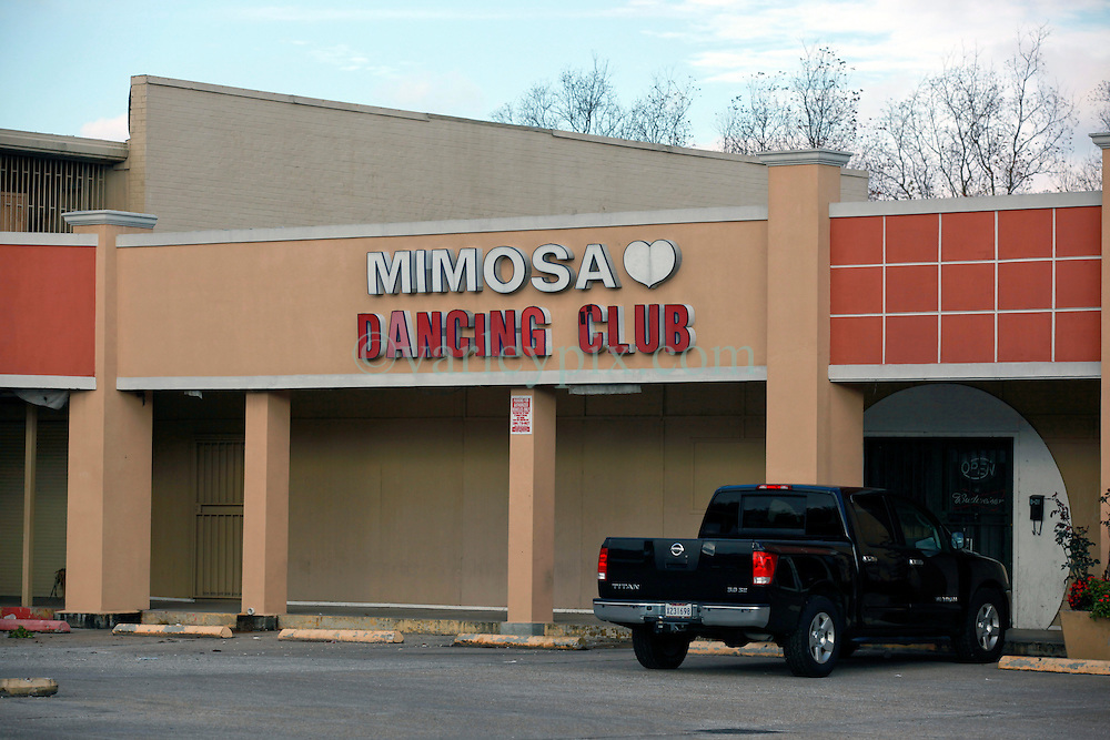 23 December 2013. New Orleans, Louisiana. <br /> The Mimosa Dancing Club in New Orleans East. <br /> <br /> The dancing club has been linked to BP claims in the media along with at least one homicide. <br /> <br /> N.B. There is no confirmation that the Mimosa club and officials from the BP Gulf Settlement program have any connection. For references please see links.<br /> <br /> Photo; Charlie Varley/varleypix.com<br /> <br /> Sources; <br /> <br /> https://www.thestateofthegulf.com<br /> <br /> http://theadvocate.com/home/7920317-125/2-top-officials-leave-bp<br /> <br /> http://www.theguardian.com/environment/2010/jun/20/deepwater-oil-spill-victims-compensation-bp<br /> <br /> http://www.news.com.au/finance/new-orleans-strip-club-mimosa-dancing-girls-files-oil-spill-compensation-claim/story-e6frfm1i-1225882007304<br /> <br /> http://www.theguardian.com/environment/2010/jun/20/deepwater-oil-spill-victims-compensation-bp<br /> <br /> http://www.news.com.au/finance/new-orleans-strip-club-mimosa-dancing-girls-files-oil-spill-compensation-claim/story-e6frfm1i-1225882007304