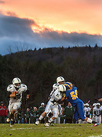 Kearsarge versus Monadnock football semifinal under the lights Saturday, November 3, 2012.  (Karen Bobotas/for the Concord Monitor)