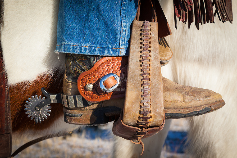 Boot with spurs in stirrup on ranch in eastern Wyoming