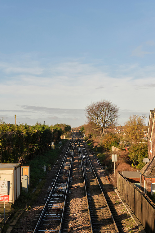 Portrait view down from the footbridge at Trimley Station. Signal switching and relay equipment on the left. The additional track on the left was added only recently to increase the capacity of the line from the Port of Felixstowe.<br /> <br /> Photo by Jonathan J Fussell, COPYRIGHT 2020