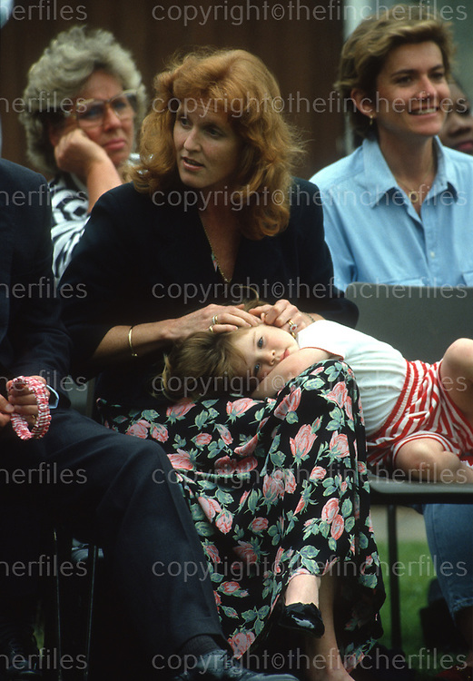 Sarah, Duchess of York seen with Princess Eugenie at the Upton House school sports day, Windsor,UK, in June 1993. Photographed by Jayne Fincher.