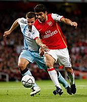 Photo: Richard Lane/Sportsbeat Images.<br />Arsenal v Newcastle United. Carling Cup. 25/09/2007. <br />Arsenal's Eduardo breaks from Newcastle's Steven Taylor.