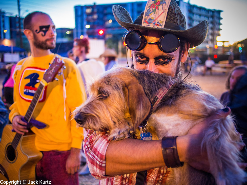 09 NOVEMBER 2013 - PHOENIX, AZ:    A participant and his dog at the 7th annual Phoenix Annual Parade of the Arts. The arts walk/parade started in 2006 and now draws hundreds of people in downtown Phoenix.    PHOTO BY JACK KURTZ