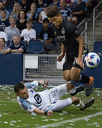June 3, 2018 - Kansas City, Kansas - Minnesota United midfielder Miguel Ibarra #10 (below) concedes a foul on Sporting KC defender Jaylin Lindsey #26 (above) during the second half of the game. (Credit Image: © Serena S.Y. Hsu via ZUMA Wire)