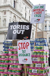 © Licensed to London News Pictures. 21/11/2017. London, UK. Foodbank donations are stacked up opposite Downing Street ahead of the budget in a protest against Universal Credit. Photo credit: Rob Pinney/LNP
