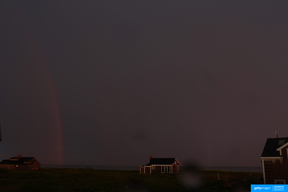 A rainbow during a thunder and lightening storm as it hits the coastline at Cisco Beach, Nantucket, Nantucket Harbor on Nantucket Island, Massachusetts, USA. Photo Tim Clayton