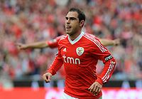 20120421: LISBON, PORTUGAL - Portuguese Liga Zon Sagres 2011/2012 - SL Benfica VS Maritimo<br /> In picture: Benfica's Bruno Cesar, from Brazil, celebrates after scoring their 4th goal against Maritimo.<br /> PHOTO: Alvaro Isidoro/CITYFILES
