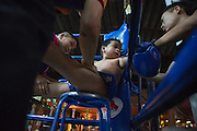 Jan 24, 2014 - Chiang Mai, Thailand - <br /> <br /> Nine Year Old Muay Thai Fighter<br /> <br /> Between rounds, Focus is given massage, drinks, and advice during his fight at the Thapae Muay Thai Stadium in Chiang Mai. PETCHFOGUS SITTHAHARNAEK, 9, aka Focus is the top fighter for his age and weight in Chiang Mai. He has begun fighting older, heavier opponents to continue to improve his skills. Fighters are typically paid 1000 baht (0) per fight. <br /> ©Exclusivepix