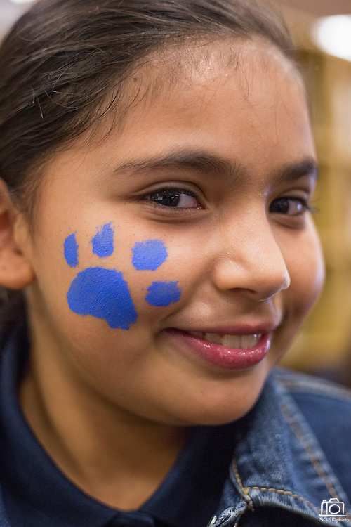 Burnett fourth grader Jessica Torres shows off her face paint during the Jack Emery Drive Brunch at Milpitas High School in Milpitas, California, on November 3, 2015. (Stan Olszewski/SOSKIphoto)