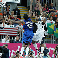 29 July 2012: USA Kobe Bryant goes for the layup over Mickael Gelabale of France during the 98-71 Team USA victory over Team France, during the men's basketball preliminary, at the Basketball Arena, in London, Great Britain.