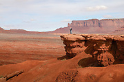 A visitor stands on John Ford Point in Monument Valley on the Utah Arizona Border